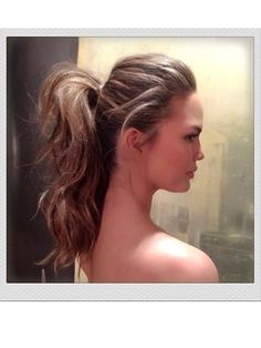 BOUNCY PONYTAIL The last person to create a ponytail this perfect was a toy designer at Mattel. To get the effect in real life, hairstylist Owen Gould misted Sachajuan Ocean Mist salt spray through Chrissy Teigen's damp hair, rough-dried it, and then curled her entire head with a one-and-a-half-inch curling iron. He sprinkled volumizing powder (we like Redken Powder Grip 03 Mattifying Hair Powder) through her roots and back-combed them, then pulled all her hair into a ponytail at the back of...
