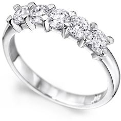 A Five Stone Eternity Ring with Four-Claw Settings.