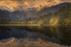Up Close, Lake Matheson, New Zealand - www.patrickmarsonong.com ___________________________________ Look closely, how many streams of water do you see coming down the mountains? Amazing right? So glad to have brought my zoom lens with me during that trip. Chanced it on a gloomy morning, hoping for a break on the clouds, maybe some dramatic sunrise? Ha!  This is Lake Matheson, located in the heart of Glacier Country and Westland National Park, This place is famous for it's mirror like views…