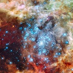 Hubble space telescope of the merging star clusters at the heart of the Tarantula Nebula, the largest star-forming region known in the local group.
