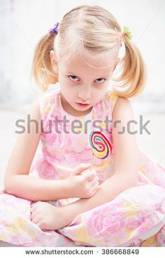 stock-photo-angry-little-girl-wit-sugar-candy-386668849.jpg (300×470)