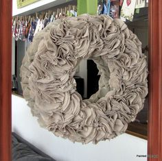 So, I had a bit of painter's cloth left over from making ruffled curtains for the kitchen. I came across a great tutorial for a felt wreath, but substituted what I had. I'm kind of loving the results. I give a full tutorial, with photos, on my blog post. ;)
