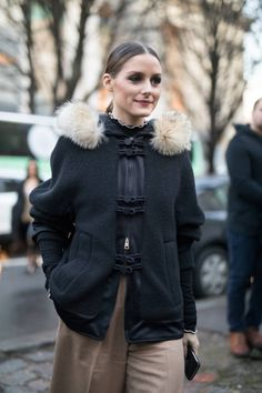 Olivia Palermo is seen on the street attending John Galliano during Paris Women's Fashion Week A/W 2018 wearing a black with fur collar coat on March...