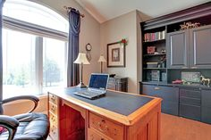 Black shelves with hardwood floors create a bold contrast in any workspace.  12715 2nd Line , Campbellville