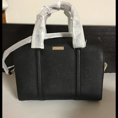 "Kate Spade Newbury Lane Cassie Large Handbag NWT! Kate Spade Newbury Lane Cassie Satchel (WKRU2690). Authentic! No dust bag included.   Black saffiano leather. Top zip closure. Handles with a 4"" drop. Detachable shoulder strap. Multiple interior pockets. Gold hardware. Dust cover included. 11"" (L) x 9"" (H) x 4"" (W). kate spade Bags Satchels"