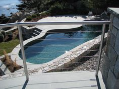 Stainless steel cable railings made with round stainless pipe and stainless steel cables.