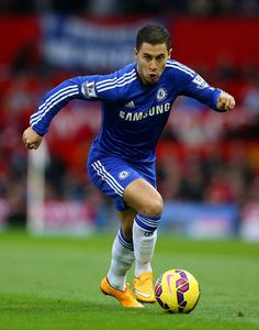 Eden Hazard Photos - Eden Hazard of Chelsea in action during the Barclays Premier League match between Manchester United and Chelsea at Old Trafford on October 26, 2014 in Manchester, England. - Manchester United v Chelsea - Premier League