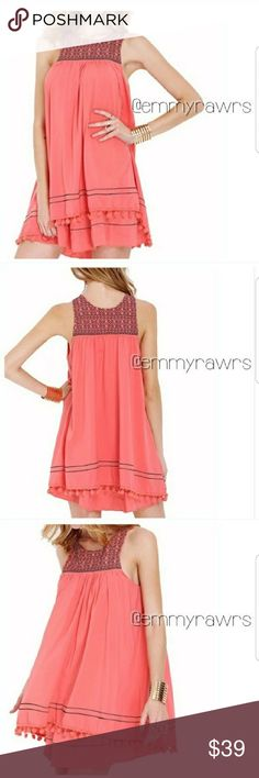 "The LAUREN PomPom Dress Add this gorgeous pop of color to your closet. Features an embroidered front and bottoms that are lined with pompoms. Dress is fully lined. Color is a gorgeous coral salmon color. Perfect for spring and summer! This dress runs big.  Rough measurements  • SMALL: bust 36"", length 32""  • MEDIUM: bust 40"", length 32.5"" Dresses"