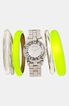 Love this shiny silver Marc Jacobs watch! The see through face adds fun to a stacked wrist.