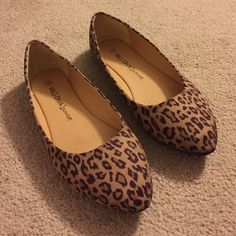 Tan flats with animal print Flaunt some subtle style by slipping into these fun flats. Worn just a couple of times ... Size says 10 but they fit more like a small 9 (I wear 9.5 so a little snug on me). This is your chance to snag a great wardrobe boost! Wild Diva Shoes Flats & Loafers
