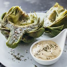 Here's the perfect foolproof recipe on how to cook artichokes! These artichokes are boiled so that you get a tender artichoke heart (doesn't get dry!).