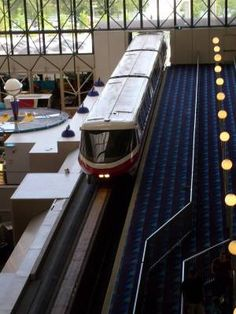 A close-up shot of the Monorail entering Disney