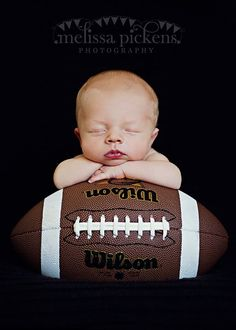 i wish i would have done this with ethan...but who knew he would be a football fanatic!! newborn photos, sports themed newborn photos #baby #photography #newborn