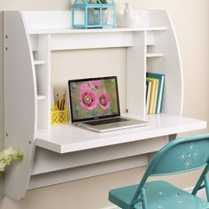 Both innovative and chic, this wall-mounted desk features side compartments and a top shelf for optimal storage.