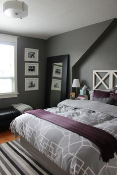 Adding purple to grey bedroom - Grey Duvet purple sheets and accents. it's Benjamin Moore Asphalt Gray on the walls, and the trim is cloud white - both in an Eggshell finish.