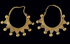 A PAIR OF ROMAN GOLD EARRINGS SYRIA, CIRCA 1ST-2ND CENTURY A.D. Formed from a plain hoop tapering to a hook-and-loop closure, the lower portion decorated on one side with a band of granulation and a plain wire, joined below to granulated triangles with a hollow ball at each tip, framed on either side by a hollow ball  | Christie's