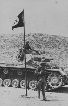 A German Wehrmacht Afrika Korps tank, with a swastika flag. This tank is a Pz.Kpfw.III.