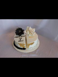 Black peonie with Gold leaf. Split celebration cake. Golden anniversary and 70th birthday cake.