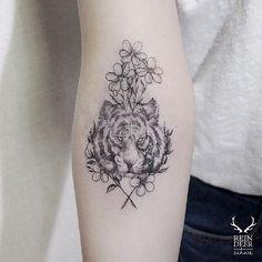 """small tattoo, tiger tattoo (maybe a """"mama bear"""" instead)?"""