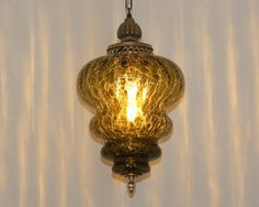 Hollywood Regency Green Crackle Glass Hanging Swag Lamp. $129.00, via Etsy.