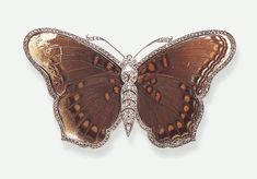 AN ATTRACTIVE DIAMOND BUTTERFLY BROOCH   Realistically designed as a butterfly, the old European, rose and single-cut diamond body extending similarly-set antennae, to the crystal encased butterfly wings with rose-cut diamond trim, mounted in 18k gold and platinum, (one diamond deficient), circa 1910, with French assay marks