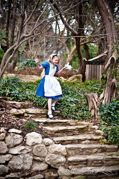 """`Well!' thought Alice to herself, `after such a fall as this, I shall think nothing of tumbling down stairs! How brave they'll all think me at home! Why, I wouldn't say anything about it, even if I fell off the top of the house!"""" Alice in Wonderland photo shoot with my oldest. Love. Miss these days!"""