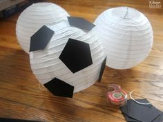 """These """"floating"""" soccer paper lanterns are the perfect addition to a sports themed kids birthday party or bedroom decor! Banquet Centerpieces, Banquet Decorations, Soccer Birthday Parties, Soccer Party, Soccer Birthday Cakes, Diy Birthday, Homecoming Floats, Soccer Banquet, Soccer Decor"""