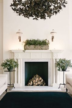 In the sitting room, arrangements of greenery contrast with the cream and black palette dd in love with the painted tin chandelier with oak leaves. Can i make one like this?