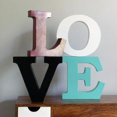 Get different letters from hobby lobby, hot glue them together and make a room decor.  I like the different colors and you can do different words.