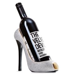 Invite the girls over for a glamorous wine party and dress up your wine with our silver high heel wine holder! Chic and sassy, this shoe wine holder features a black stiletto heel, silver sparkles, ...