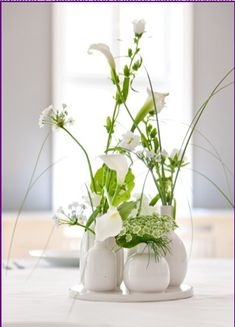 White flowers in white vases or use blue vases with Dusty Miller.