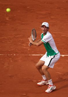 Dominic Thiem Photos Photos - Dominic Thiem of Austria plays a forehand during the mens singles first round match against Bernard Tomic of Australia on day one of the 2017 French Open at Roland Garros on May 28, 2017 in Paris, France. - 2017 French Open - Day One