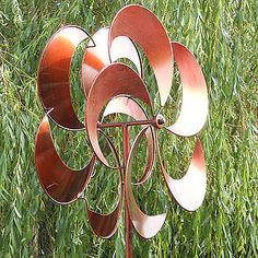 Copper+Wind+Spinners+On+Pole | ... kinetic wind spinner / wind sculpture in a polished copper colour