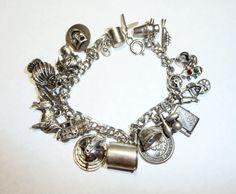 Vintage Sterling Silver Bracelet and 19 Charms on by apurplepalm, $159.00