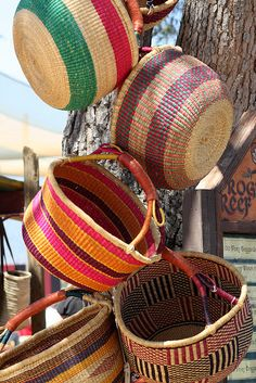 handwoven baskets...hang like this instead of hiding away in a closet!