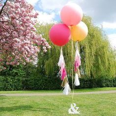 giant round tasselled helium balloons by eagle eyed bride   notonthehighstreet.com