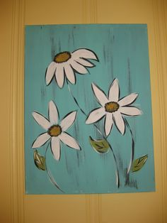 light blue canvas painting with daisies