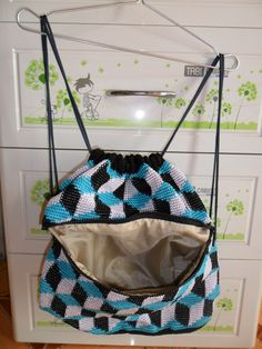 Drawstring backpack crocheted by me.
