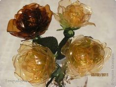 plastic roses from soda bottles... The directions are in Greek, but the pictures look pretty self explanatory.