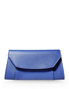 This blue color textured leather bag has a snap button closure,internal pocket giving a perfect look.