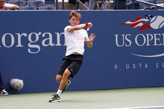 David Goffin (BEL) in action against Tomas Berdych (CZE)[6] in the first round of the US Open. - Philip Hall/USTA
