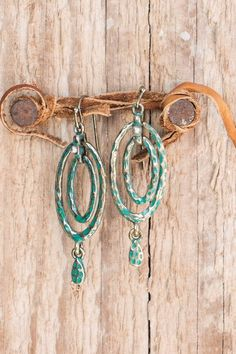 Artfully handcrafted earrings that exude sophistication and class. These earrings take on a vintage feel with a hammered patina and gold design that resembles aged metal. They're unique and effortless
