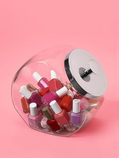 Store nail polish in old-fashioned glass candy jars.