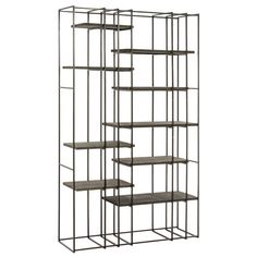 A visually graphic étagère that combines a natural iron framework with sandblasted gray wood shelves. Plenty of space for your collectibles or books. Use in large loft-like spaces as a room divider or place next to a wall as a bookcase.    Material: Iron, Wood  Finish: Natural