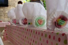 Valeria's Baking Party | CatchMyParty.com, Love the chef hats with cupcake wrapper flowers.