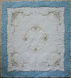 My quilt, Anna LaFrance, is actually a small tablecloth which has been sewn to the blue fabric and quilted on my longarm. I learn this technique from Cindy Needham, while attending MQX several ye…