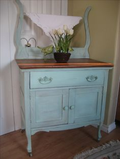 Freshly UPcycled! This pretty antique washstand is finished in a mix of duck egg blue and a soft green chalk paint. After some soft distressing I brushed in a mix of black and deep brown antique waxes for a sweet, subtle aged effect. The top has been stripped down and given a fresh coat of provincial stain then sealed with poly for durability. Antique Dry Sink, Antique Wash Stand, Furniture Makeover, Diy Furniture, Hutch Makeover, Antique Furniture, Chalk Paint Dresser, Chalk Paint Furniture, Chalk Paint Projects