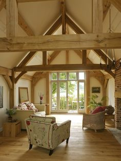 Border Oak - full height sitting room in a barn style home with feature oak trusses.