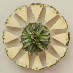 Cut pineapple on a plate. by Mosuno