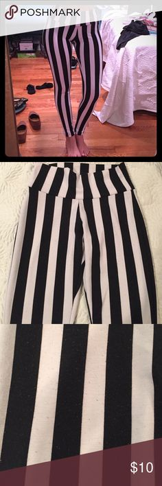 Black and white high wasted striped leggings Leggings are in good condition and can fit sizes 0 to 2. Some Pilling on fabric as shown in the last picture. Pants Leggings